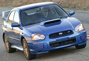 its all slick and trick but its not alone in the super compact class because subaru has finally unleashed its ultimate impreza wrx the sti - Mitsubishi Evolution 2004